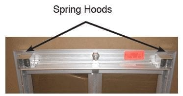 Spring hoods on a PlexiDor dog door