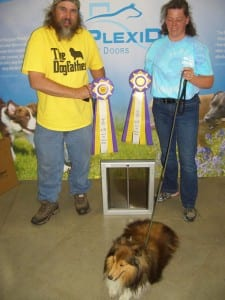 Here is Toby with his owners, Kim Charles and Bruce Winter.